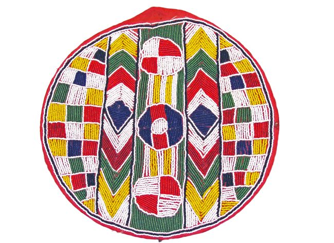 Circular beadwork mat in green, yellow, white, red and blue.  THe design is split into five horizontal sections and includes circles and chevrons.