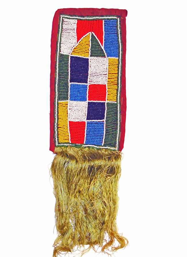 Rectangular beadwork in grey, light blue, dark blue, red and yellow design.  The at has tassles at one end.