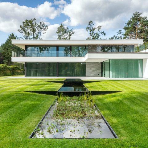 Modern villa garden with overflow as a waterfall