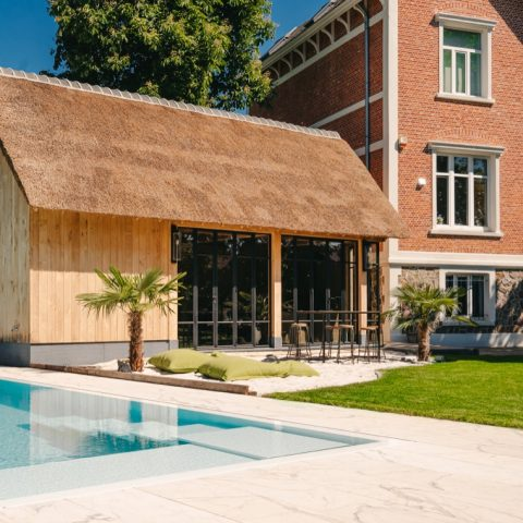 Exclusive oak pool house with thatched roof