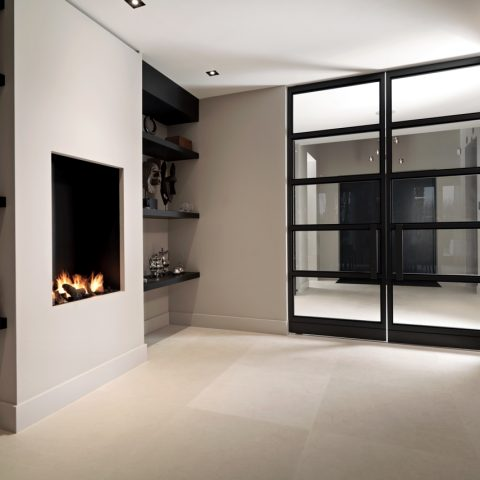 Fireplace in kitchen incorporated in cupboard wall