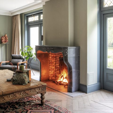 Black marble stone fireplace