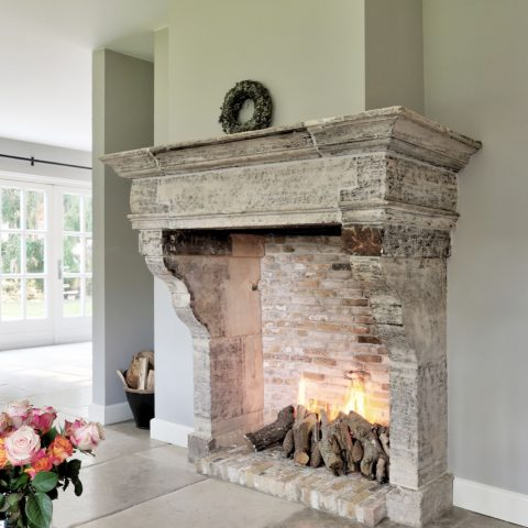French antique limestone fireplace
