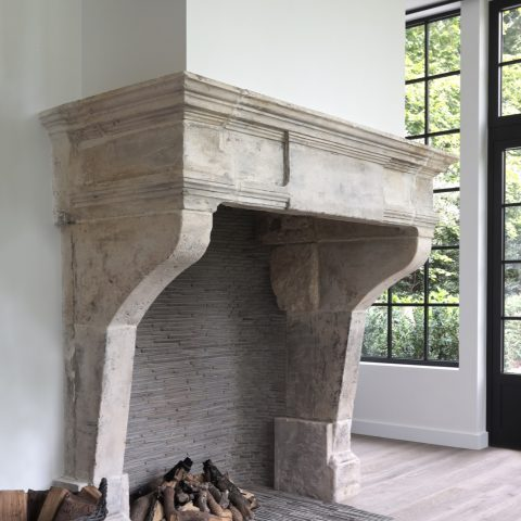 Antique mantel in French limestone