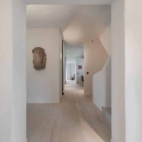 Kamerlange planken, van muur tot muur