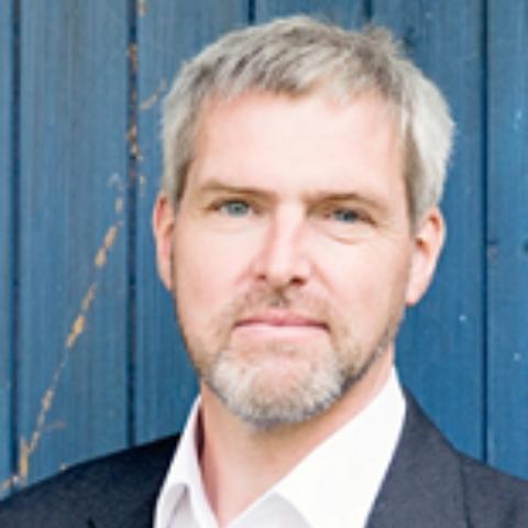 Portrait photograph of Dr Paul Stookes