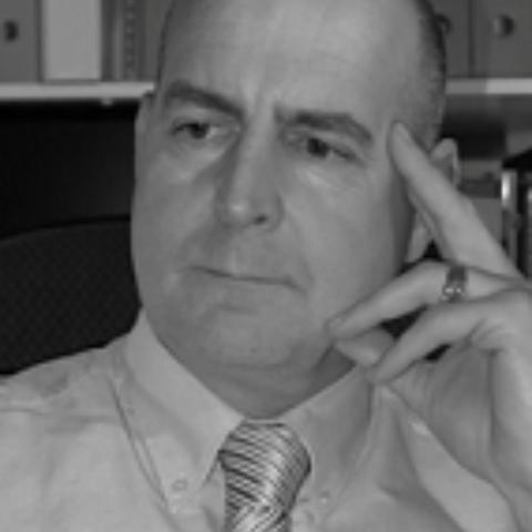 Portrait photograph of Simon Cordingley