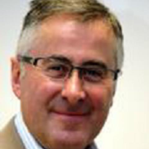 Portrait photograph of Tim Roberts