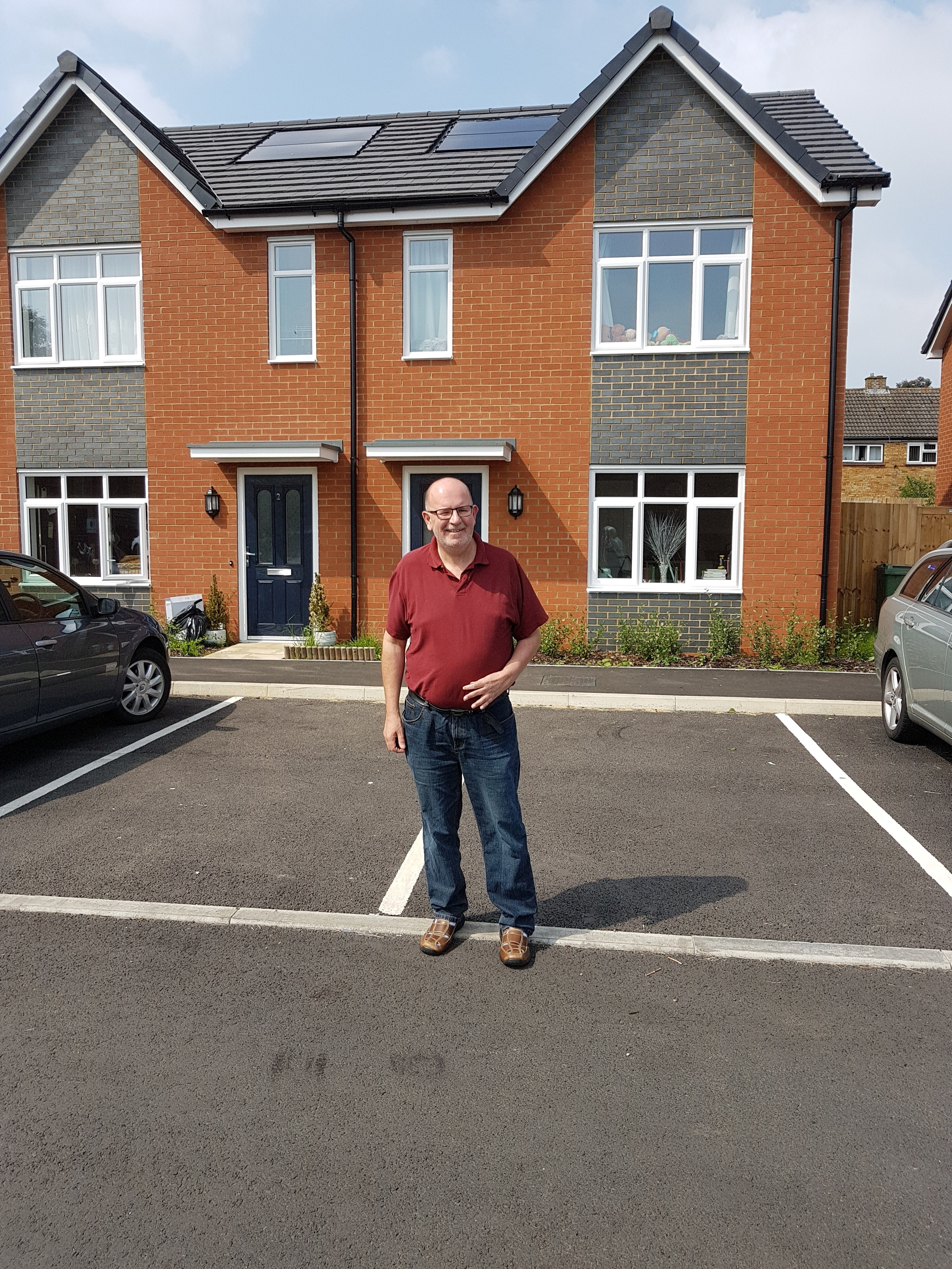 Cllr_Long_ous_tside_newly_opened_council_houses_off_of_Whaddon_Way__Bletchley.jpg