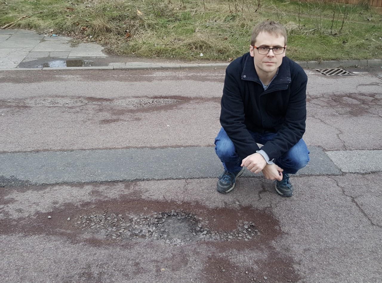 Martin_Gowans_and_a_pothole.jpg