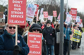 Labour Party placards at there QEQM save our stroke services demo