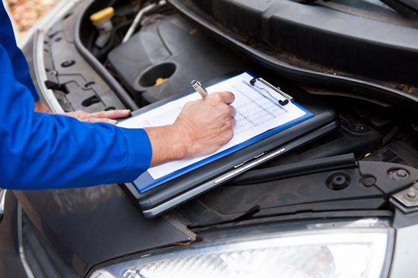 Mechanic filling in job sheet
