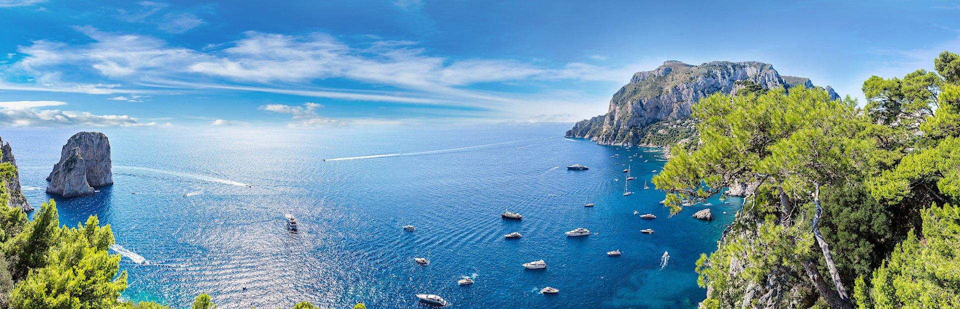 blue waters and sunny skies yachts cruising amalfi coast