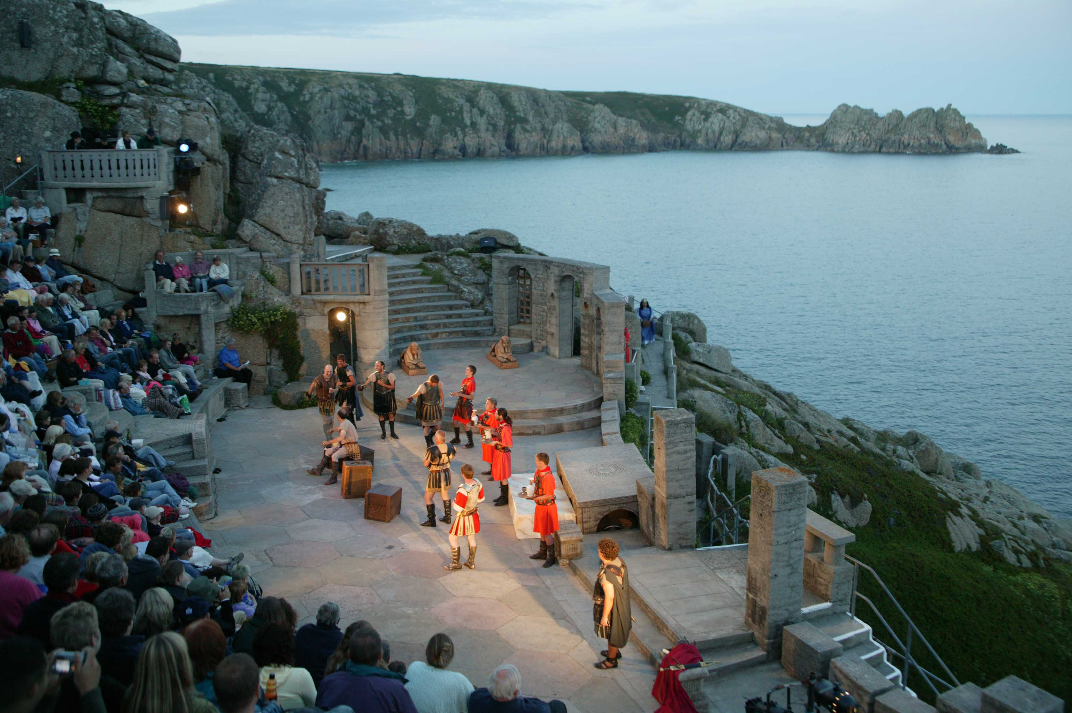 Actors on stage at the Minack theatre