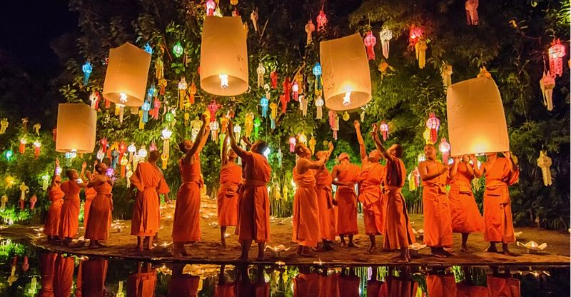 Monks looking at Yi Peng Lantern Festival