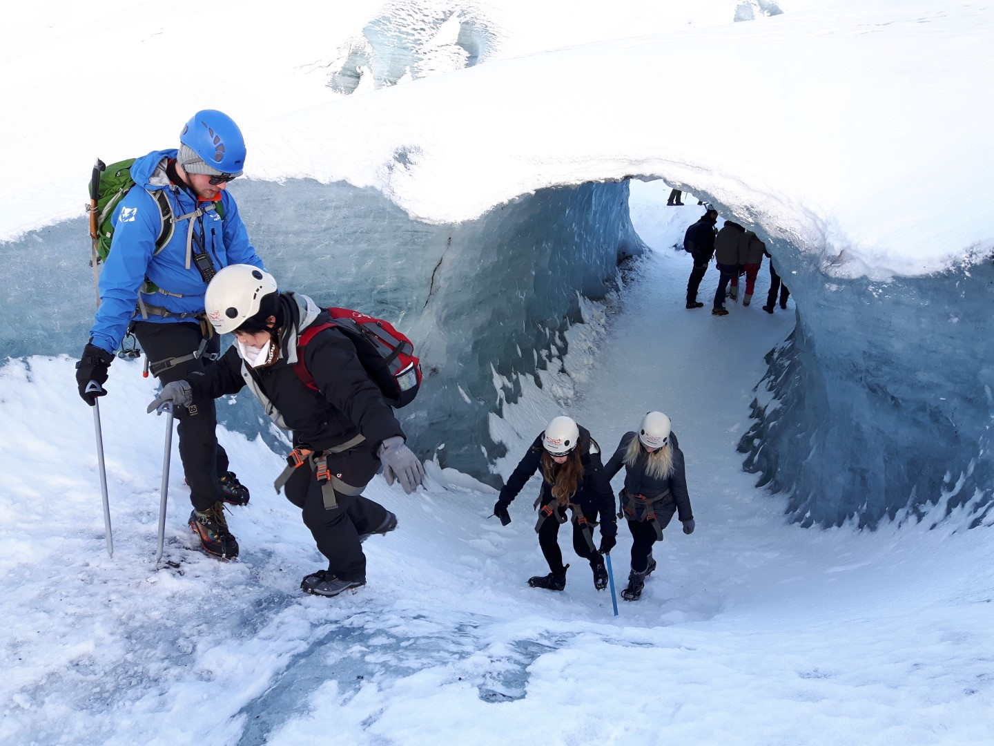 Group of People Glacier Climbing in Iceland