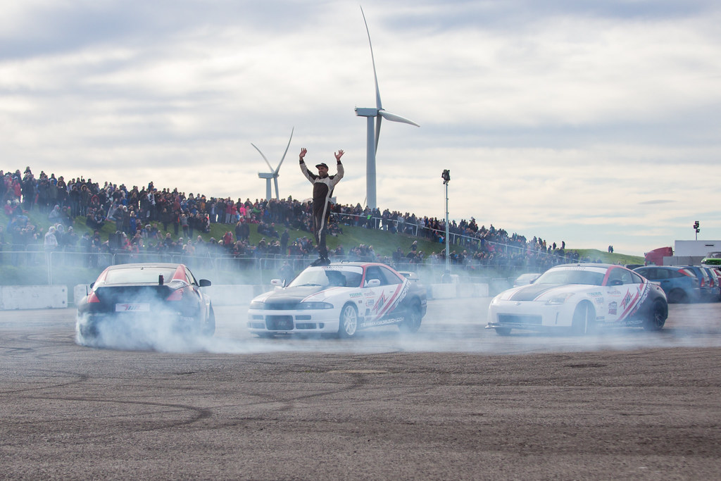 Racer standing on cars at Flame and Thunder