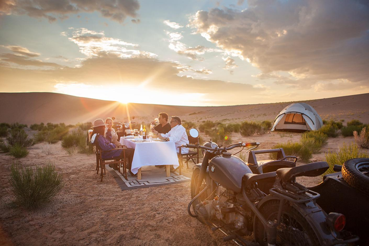 People dinning outdoor at Three Camel Lodge Mongolia