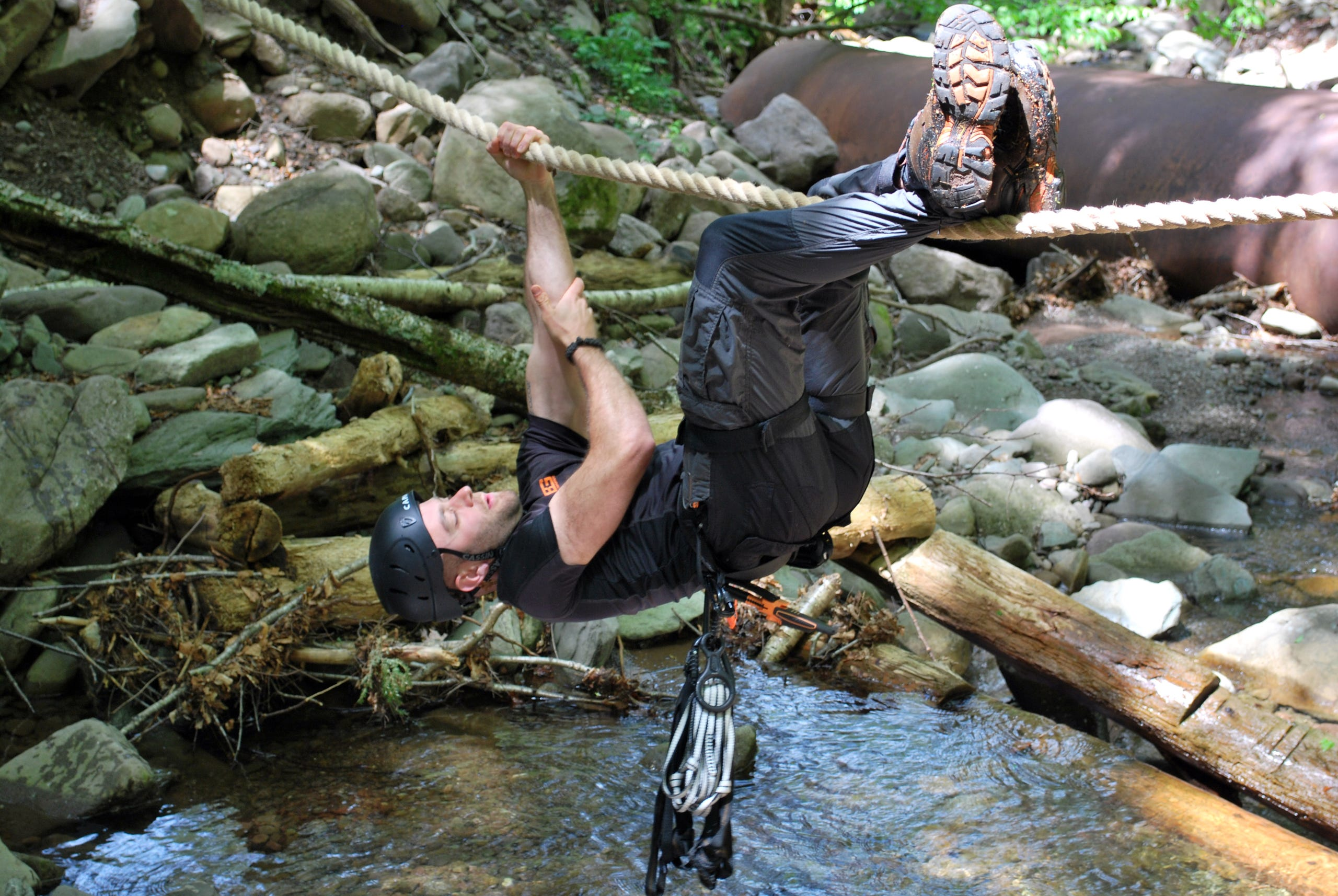 Man on rope at Bear Grylls Survival Academy