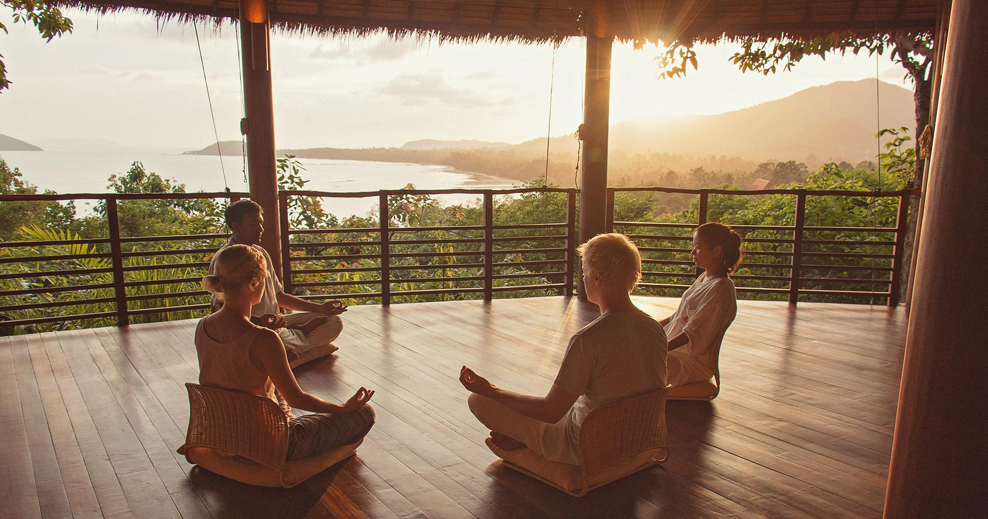 Group of people meditating at Kamalaya Detox Spa