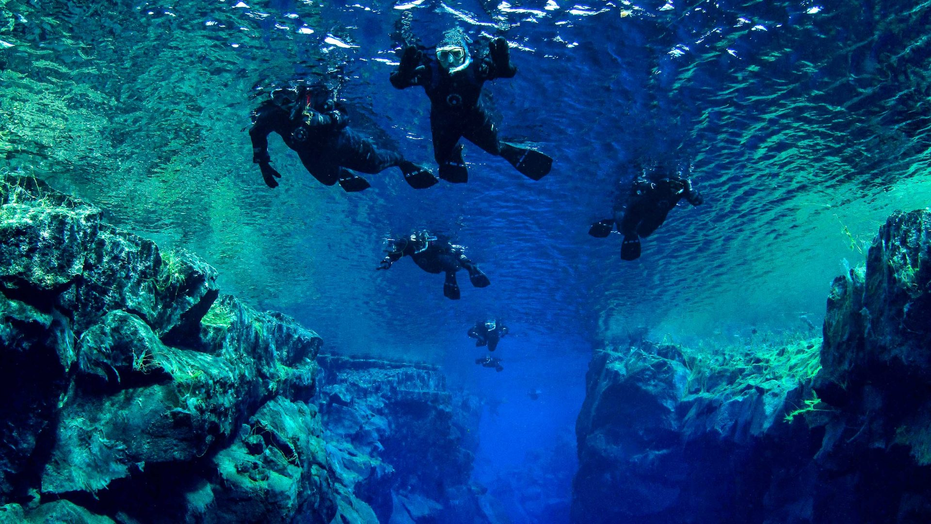 Scuba divers in Iceland Thingvallavatn Lake