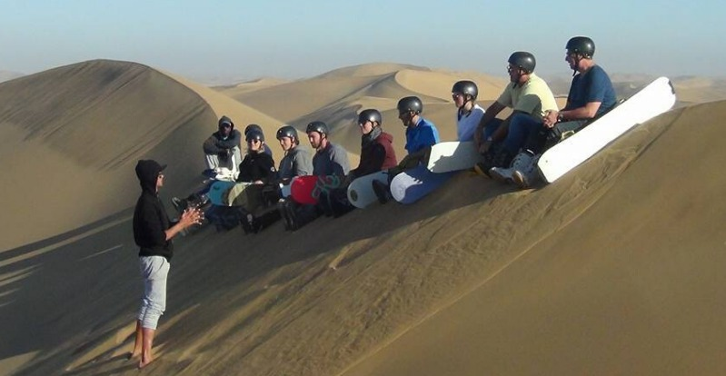 Sandboarding students in the Namib Desert