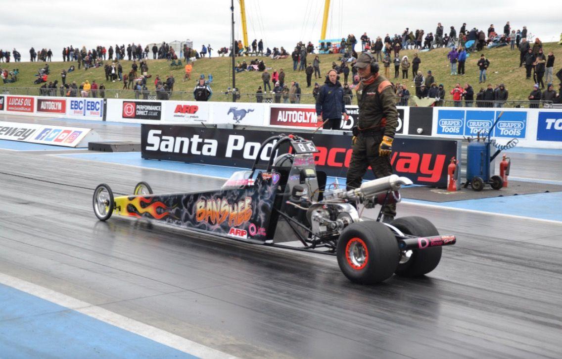 Car on track at Flame and Thunder Santa Pod Raceway
