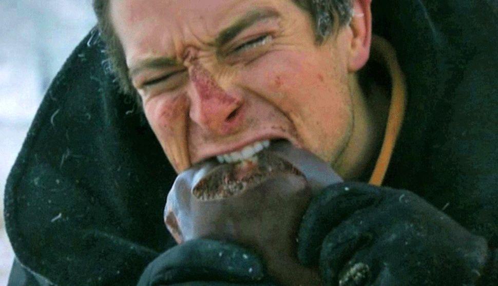 Man eating fish at Bear Grylls Survival Academy