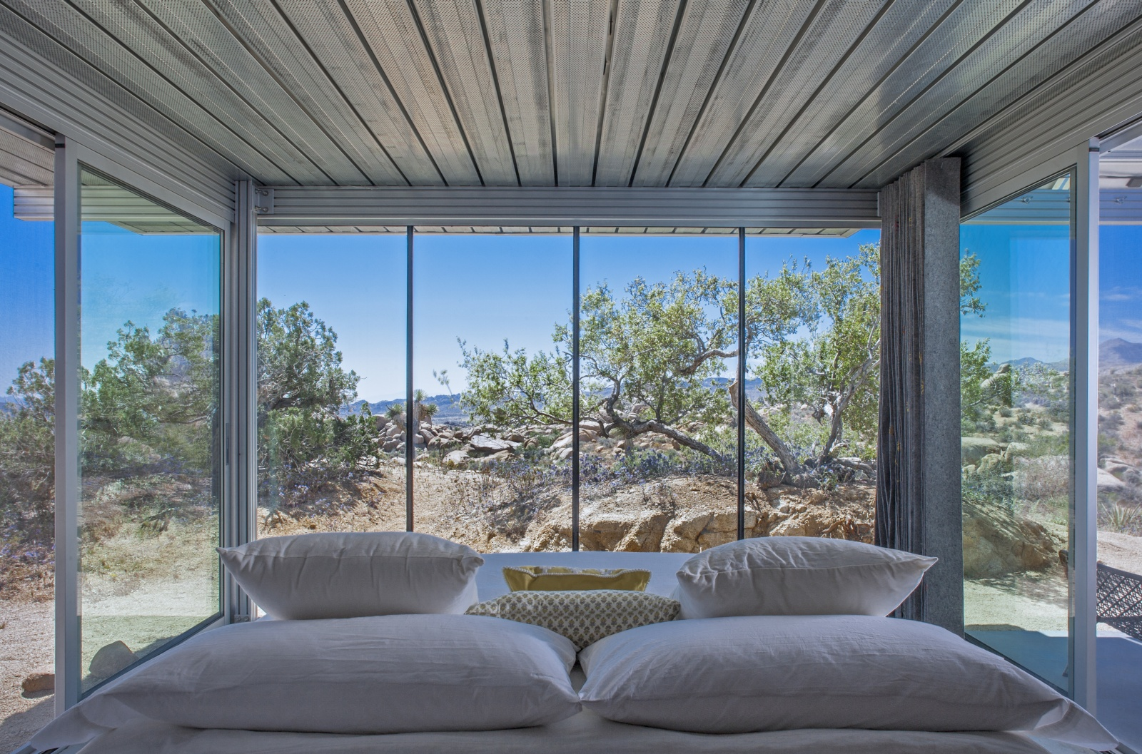 Off-Grid itHouse master bedroom looking outside windows