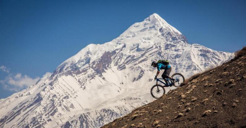 Man riding bike on Treasures of the Himalayas Mountain Biking