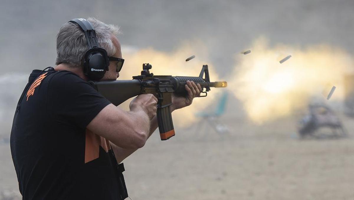 Man shooting gun at Knob Creek Machine Gun Shoot