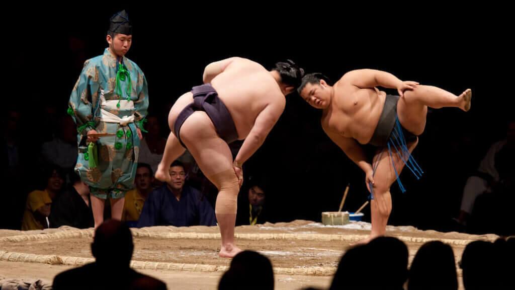 Sumo wrestlers in ring at Grand Sumo Tournament