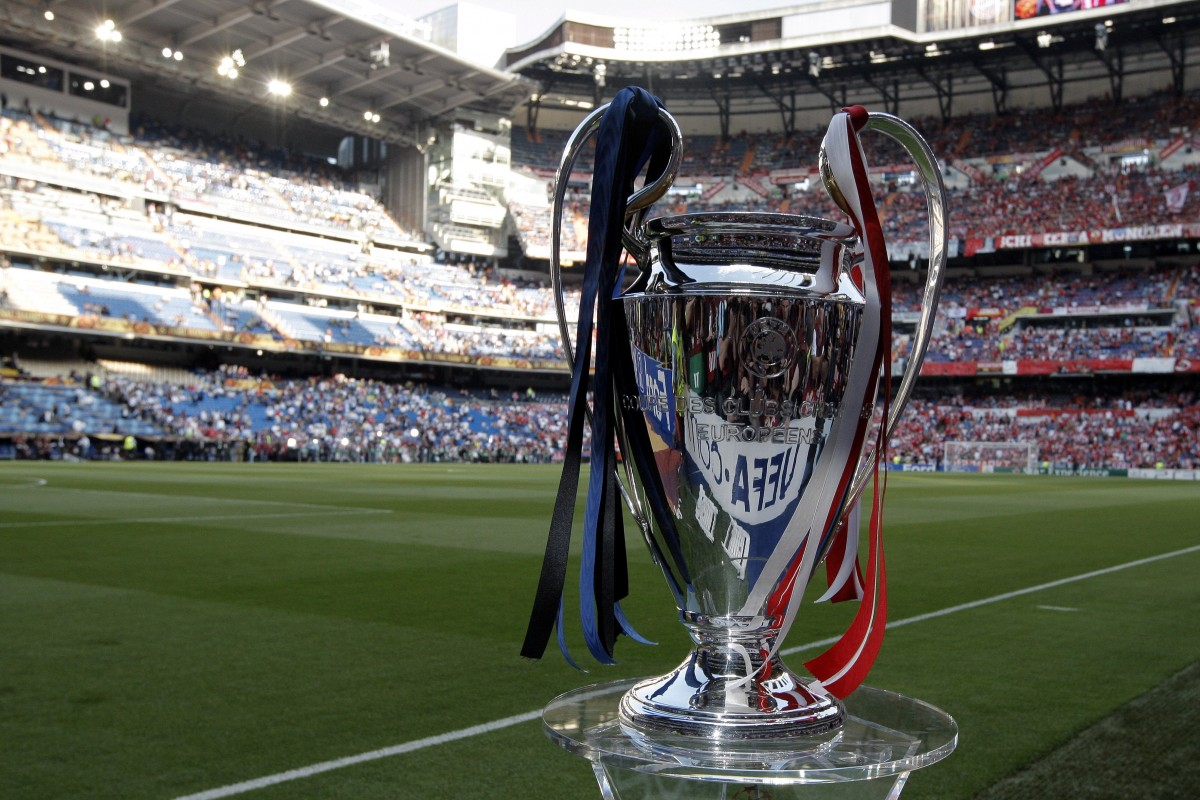 champions league final trophy on pitch