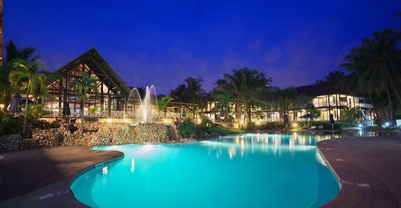 labadi beach hotel pool at fountains at night