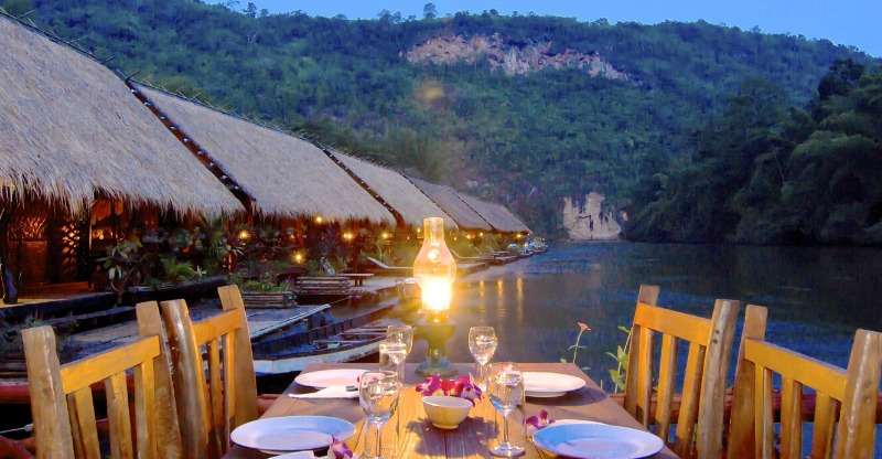 dining table set with view of river kwai jungle rafts