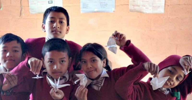 group of nepalese children with origami cranes