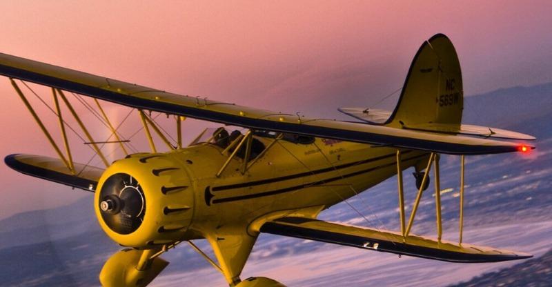 stunt plane at sunset