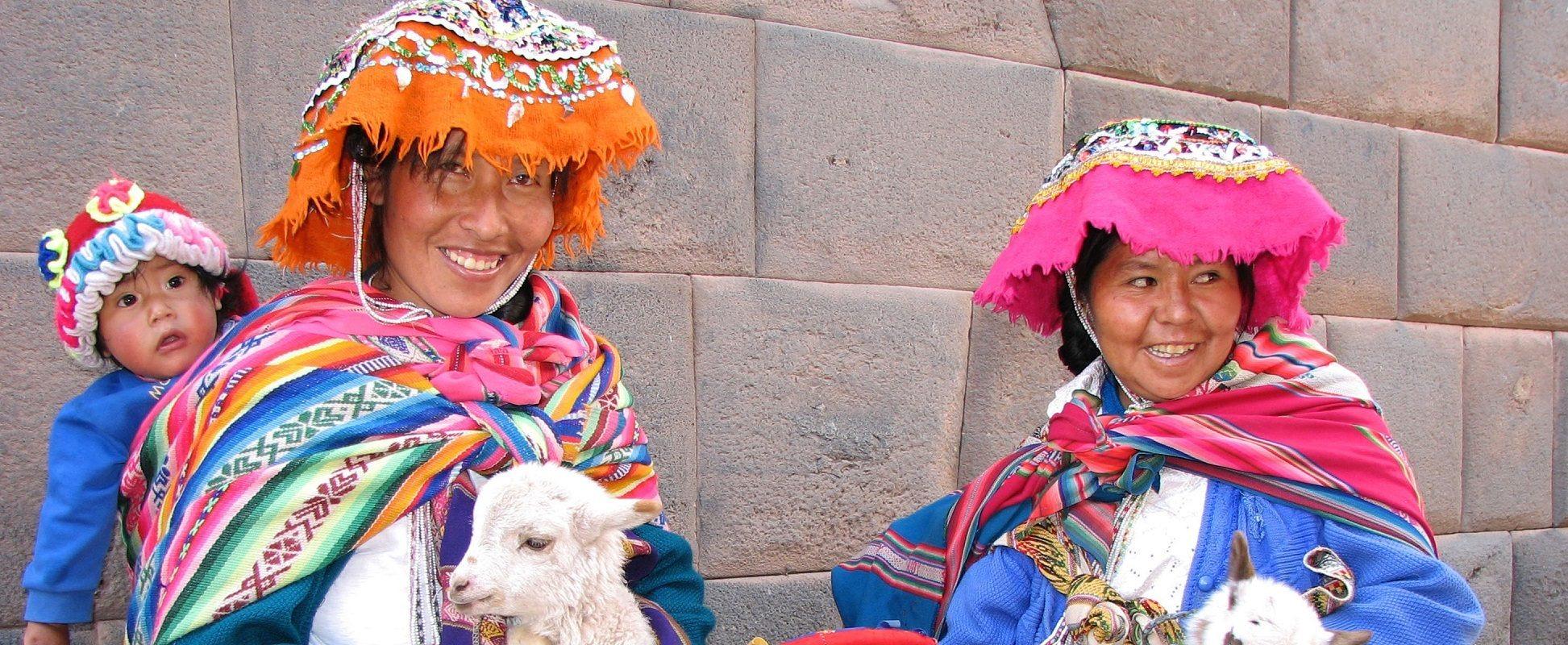 women in traditional peruvian dress on galapagos and machu pichu tour