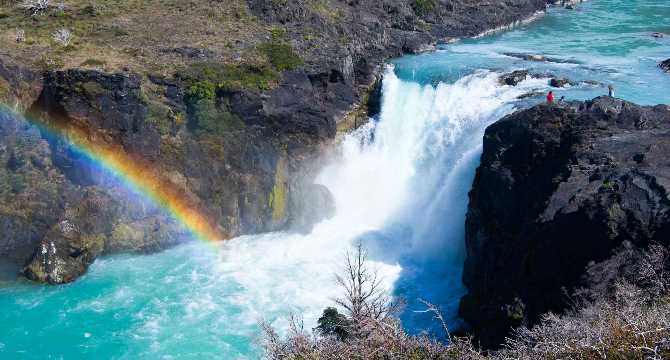 waterfall and rainbow on patagonia camping and photography