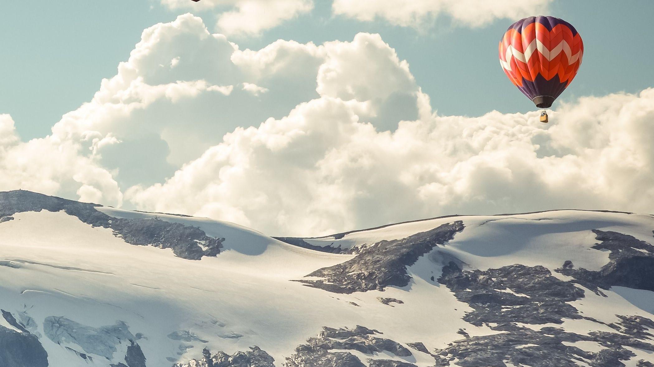 hot air balloon over the himalayas