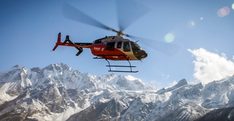 helicopter in himalayas for heli-biking mount everest