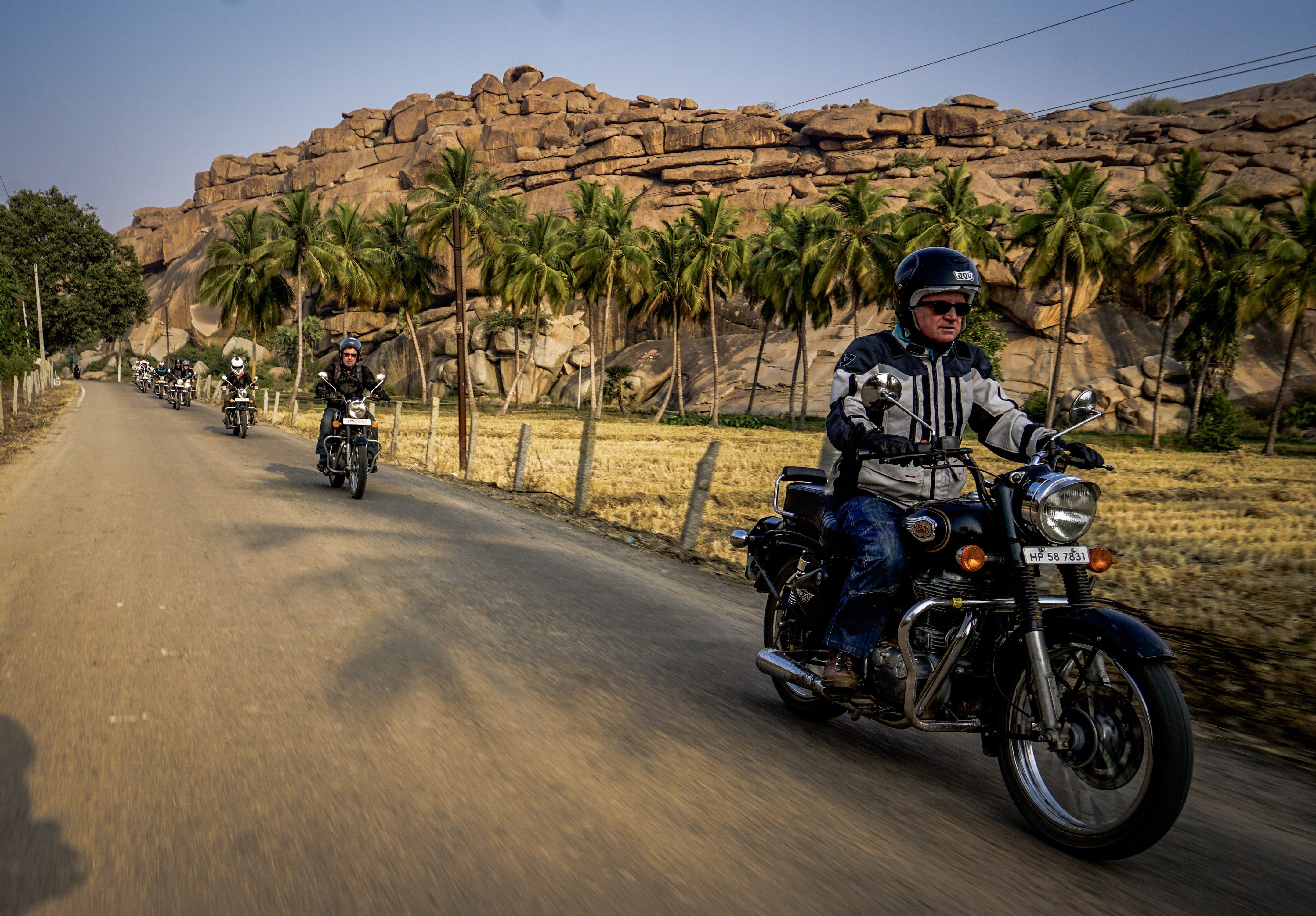 motorbikes touring in India with palm trees and desert