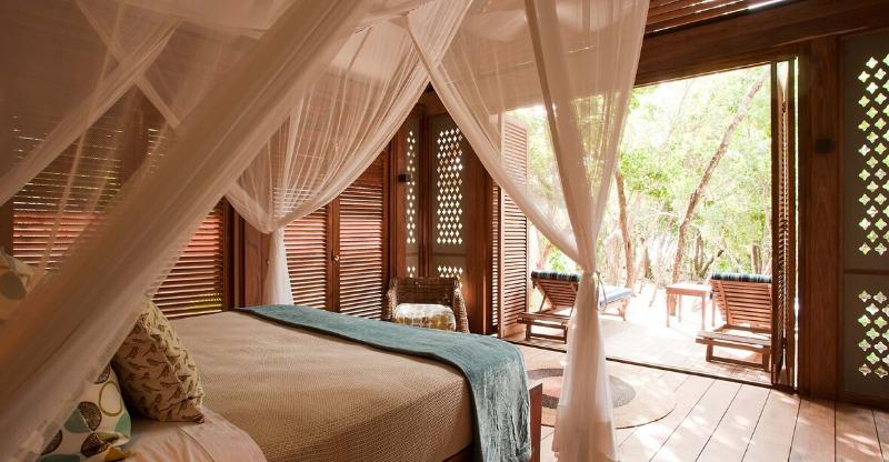 vamizi lodge luxury bedroom looking out onto sundeck