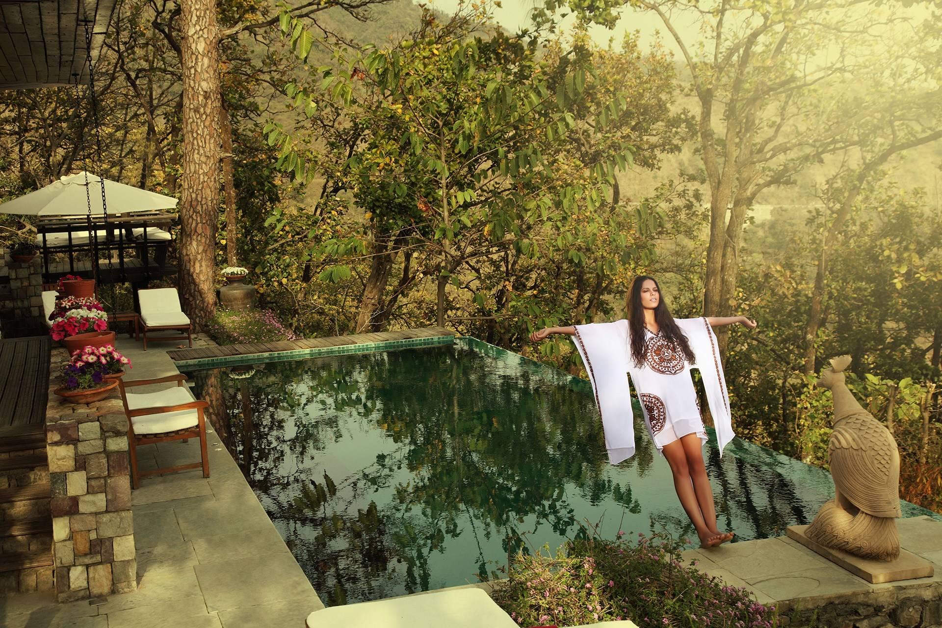 woman in kimono next to pool ananda spa