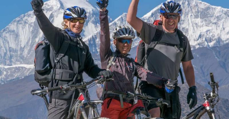 mountain bikers at top on heli-biking everest tour