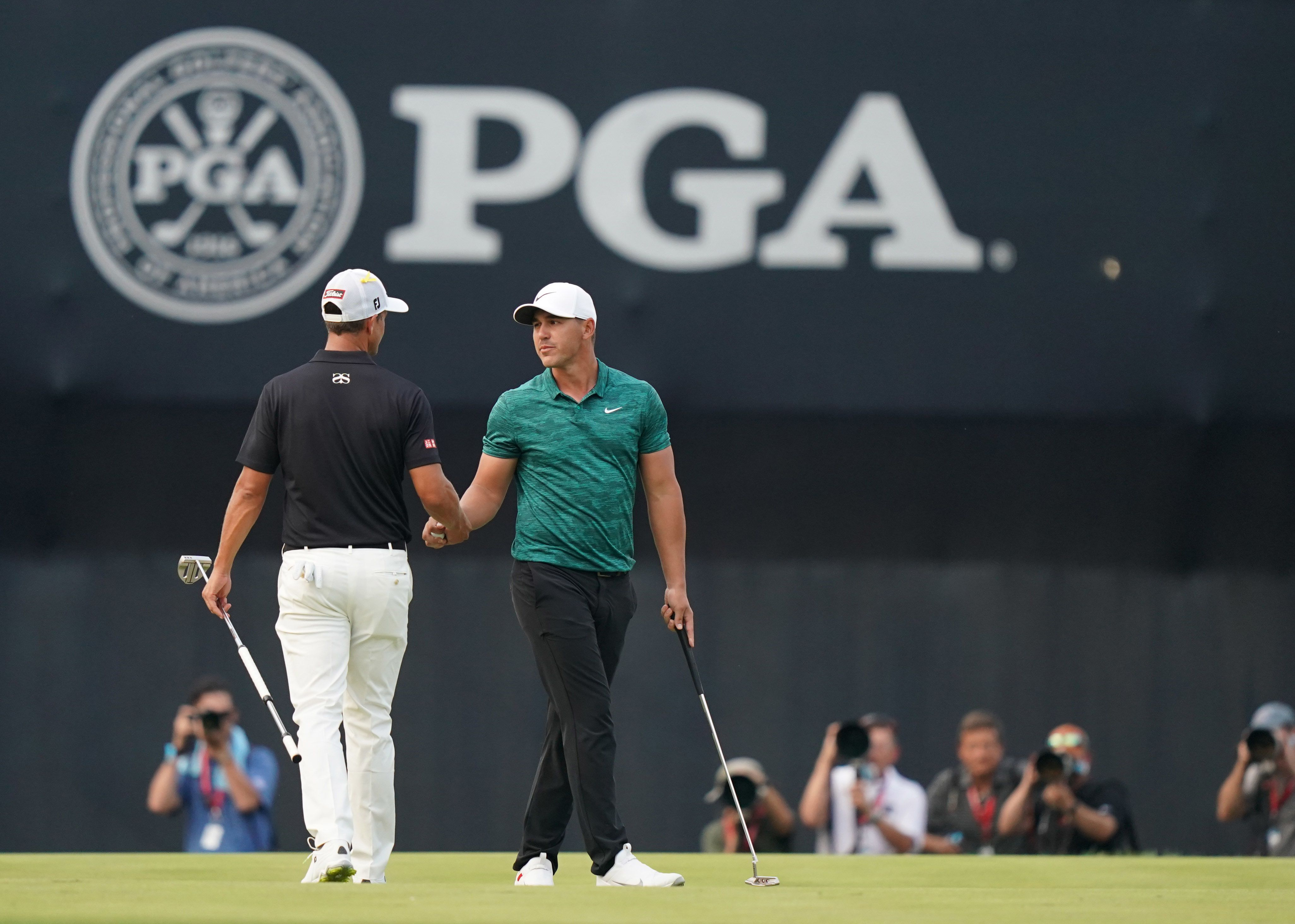golfers shaking hands at the pga championships