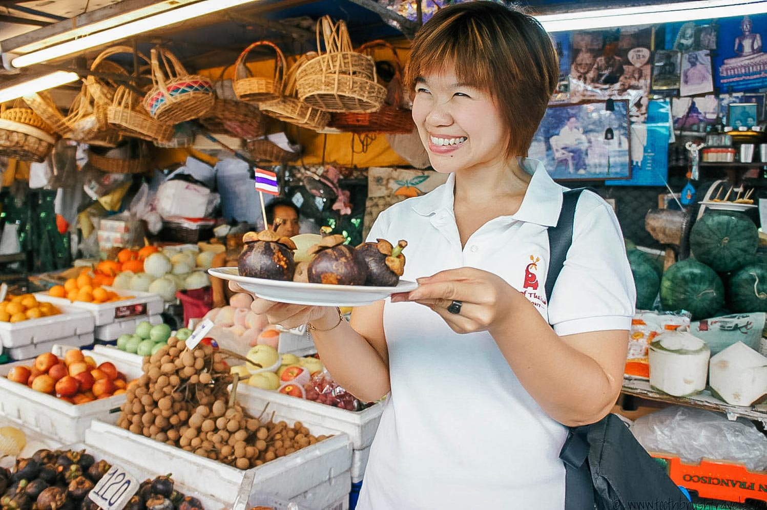 tour guide smiling with food on Taste of Thailand Culinary Tours