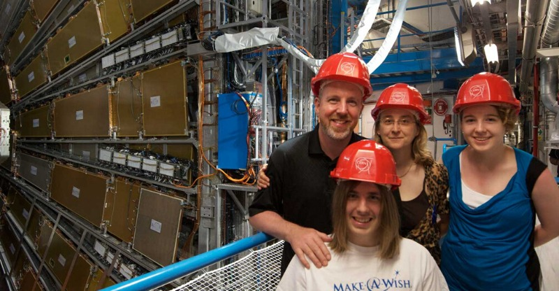 family with hard hats visiting CERN