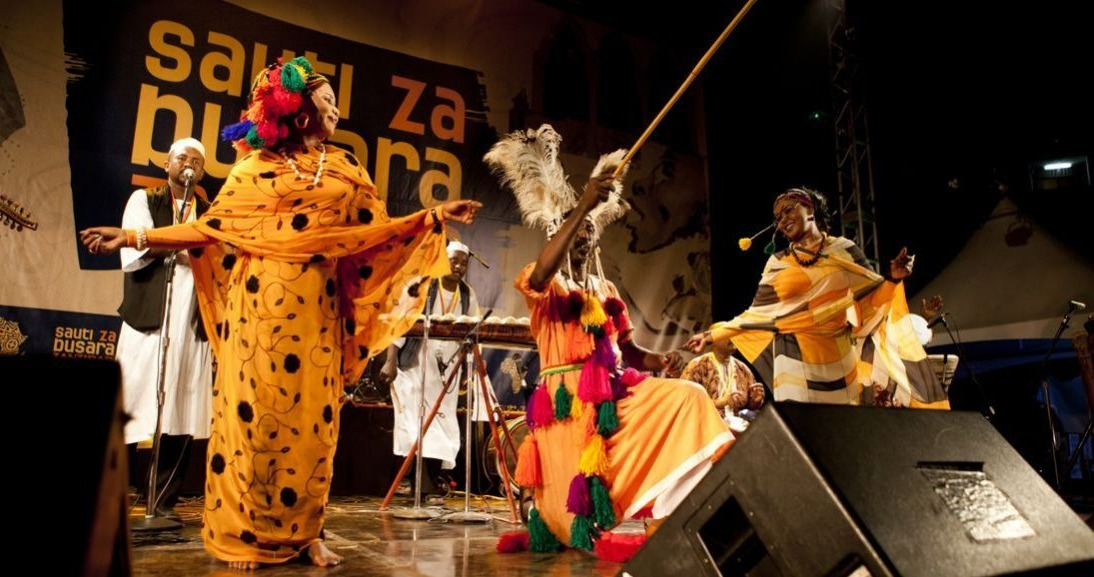 african costumed musicians on stage at sauti za busara