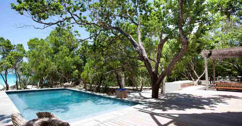 vamizi private island swimming pool, trees and loungers
